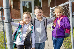Students outside school standing together Stock Photography
