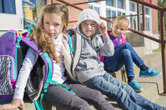 Students outside school standing together Royalty Free Stock Photo