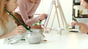 Group of students painting at art lessons. 4k 20s. Group of students painting at art lessons 4k 20s stock footage