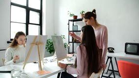 Group of students painting at art lessons 4k 20s stock footage