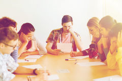 Group of students with papers. Education, high school, learning and people concept - group of students with papers thinking or making test Stock Image