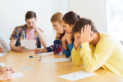 Group of students with papers Royalty Free Stock Photos