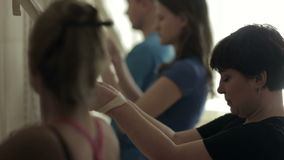 Group of students performing exercise. Group yoga class at the gym stock video footage