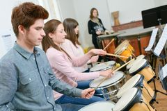 Group students playing in school orchestra together. Group of students playing in school orchestra together Stock Image