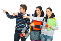Group of students pointing to copy Stock Images