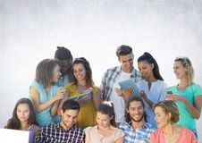 Group of students reading in front of grey background Royalty Free Stock Images