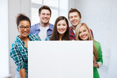 Group of students at school with blank board Stock Photo