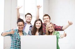 Group of students at school with blank board Royalty Free Stock Photo