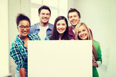 Group of students at school with blank board Royalty Free Stock Photography
