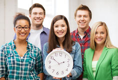 Group of students at school with clock Royalty Free Stock Images