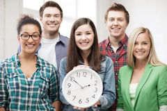 Group of students at school with clock Royalty Free Stock Photography
