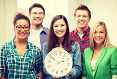 Group of students at school with clock Stock Photography