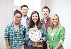Group of students at school with clock Royalty Free Stock Image