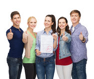 Group of students showing test and thumbs up Stock Photo
