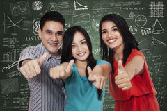 Group of students showing thumbs up 3 Stock Photo