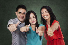 Group of students showing thumbs up 4 Royalty Free Stock Photo