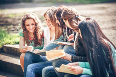 Group of students sitting with a books Stock Photography