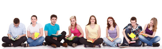 Group of students sitting on the floor  Royalty Free Stock Images