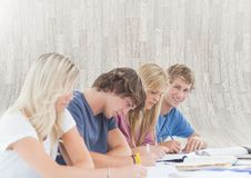 Group of students sitting in front of bright background. Digital composite of Group of students sitting in front of bright background Stock Photo