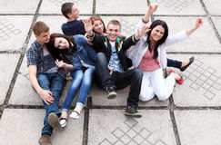 Group Students Sitting On Street Royalty Free Stock Photo