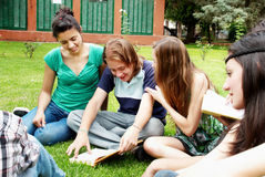 Group of students sitting in park Stock Photos