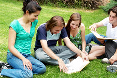 Group of students sitting in park Stock Photo