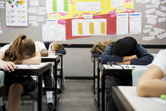 Group of students sleeping in the classroom. Students sleeping in the classroom Stock Images