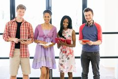 Group of students standing with books. Group of students standing in row with books in their hands Royalty Free Stock Image