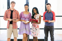 Group of students standing with books. Group of students standing in row with books in their hands Stock Photography