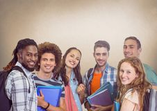 Group of students standing in front of blank brown background Royalty Free Stock Images