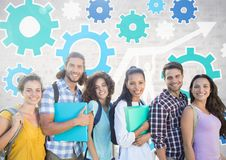 Group of students standing in front of brick grey background with cog wheel settings graphics Royalty Free Stock Photo