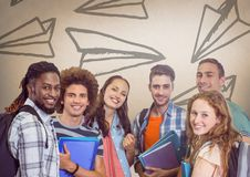 Group of students standing in front of paper airplane graphics Royalty Free Stock Photo
