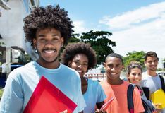 Group of students standing in line. Outdoor in the city in the summer Stock Photography