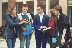 Students prepare for classes. A group of students stands and prepare for classes before the university stock photos