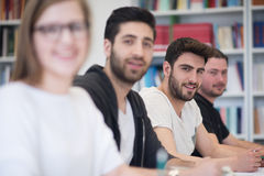 Group of students study together in classroom Stock Photography