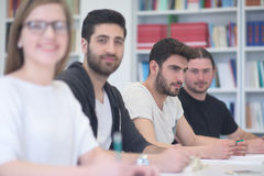 Group of students study together in classroom. Students group study together in school classroom and working together homework project Royalty Free Stock Photo