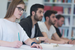 Group of students study together in classroom. Students group study together in school classroom and working together homework project Royalty Free Stock Photos