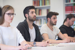 Group of students study together in classroom. Students group study together in school classroom and working together homework project Royalty Free Stock Photography