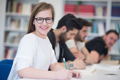 Group of students study together in classroom Stock Image