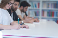 Group of students study together in classroom Royalty Free Stock Images