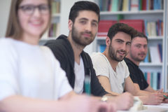 Group of students study together in classroom Stock Photo