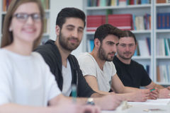 Group of students study together in classroom Stock Photos