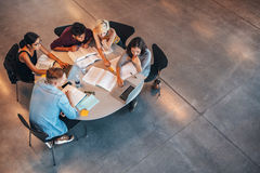 Group of students studying on laptop Royalty Free Stock Photography