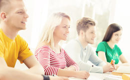 Group of students studying at the lesson. Group of teenage students studying at the lesson in the classroom Royalty Free Stock Image