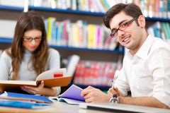 Group of Students studying in a library Royalty Free Stock Image