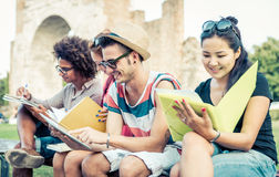 Group of students studying outdoor. Concept about education, people and friendship Stock Photos