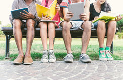 Group of students studying outdoor. stock photos
