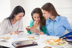Group of students studying together at home Royalty Free Stock Images