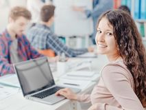 Group of students studying together and smiling girl stock image