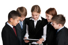 Group of students with a  tablet Royalty Free Stock Photos